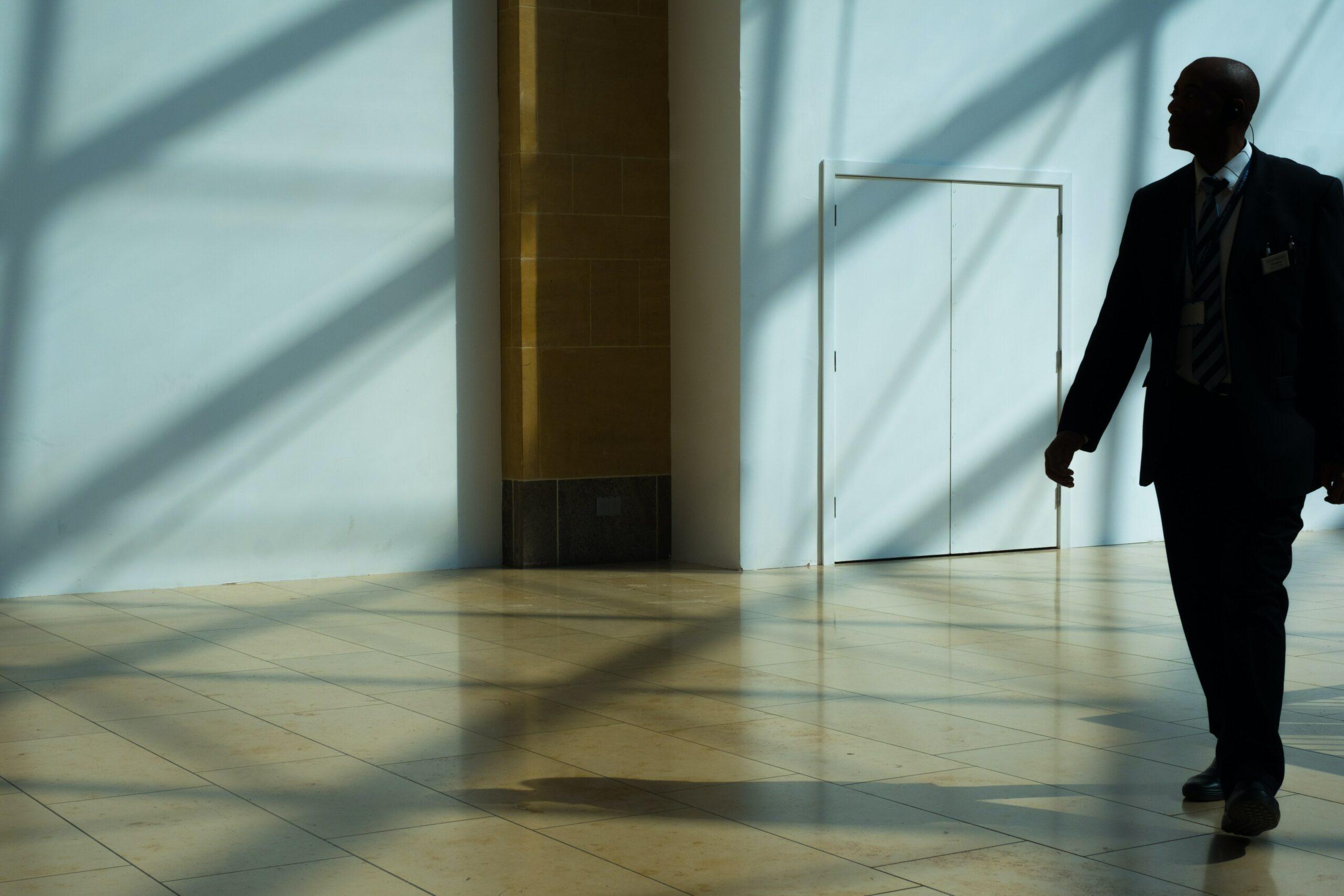 man walking on hallway